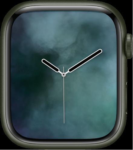 중앙에 아날로그 시계가 있고 주위에 연무가 있는 연무 시계 페이스.