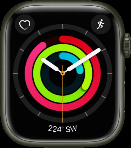 시간과 함께 움직이기, 운동하기 및 일어서기 목표 진행 상황이 표시된 활동(아날로그) 시계 페이스. 더불어 표시된 세 개의 컴플리케이션으로 왼쪽 상단에 심박수, 오른쪽 상단에 운동, 하단에 나침반이 있음.