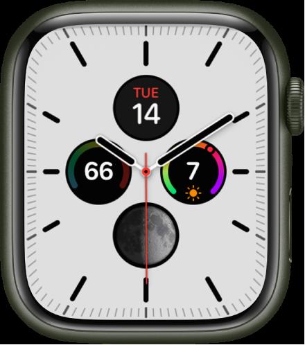 자오선 시계 페이스에서 페이스 색상 및 다이얼 세부사항을 조절할 수 있음. 아날로그 시계 페이스 안에 표시된 네 개의 컴플리케이션으로 상단에 캘린더, 오른쪽에 자외선 지수, 하단에 문페이즈 및 왼쪽에 온도가 있음.