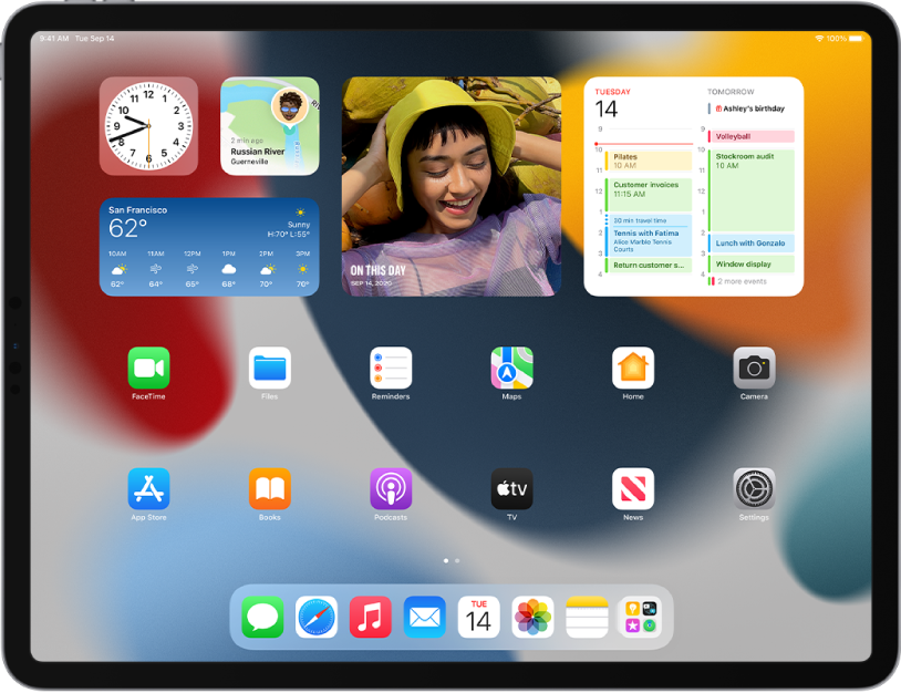 The iPad Home Screen. At the top of the screen are the Clock, Find My, Weather, Photos, and Calendar app widgets.