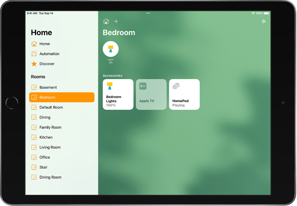 The Home app with the sidebar on the left. Under Rooms, Bedroom is selected in the sidebar. To the right of the sidebar, at the top, are the Home Settings button and Add button. The Intercom button is at the top right. A status button for a light is near the top, indicating that the light is on. Accessory buttons for bedroom lights, Apple TV, and HomePod appear below.