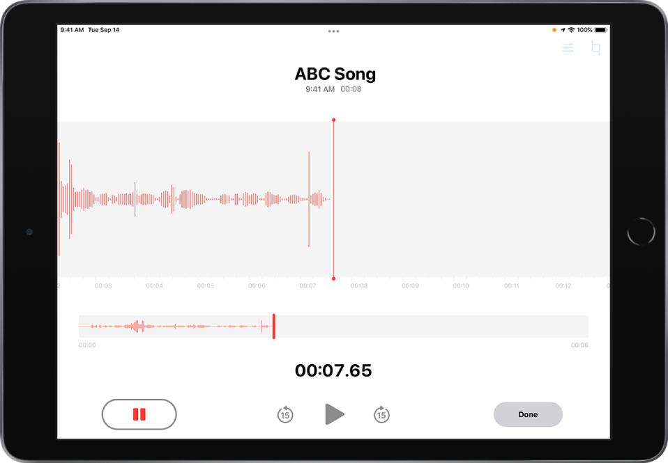 A Voice Memos recording in progress, with an active Pause button and dimmed controls for playing, skipping forward 15 seconds, and skipping backward 15 seconds. The main part of the screen shows the waveform of the recording that's in progress, along with a time indicator. The orange Microphone In Use Indicator appears at the top right.