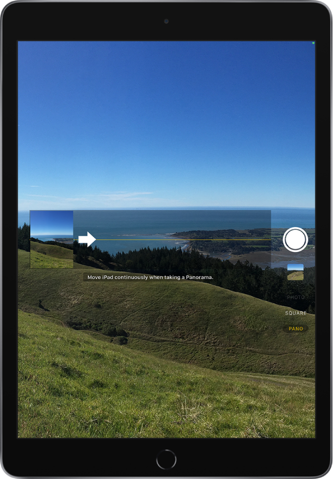 Camera in Panorama mode. An arrow, left of center, points right to show the direction of the pan.