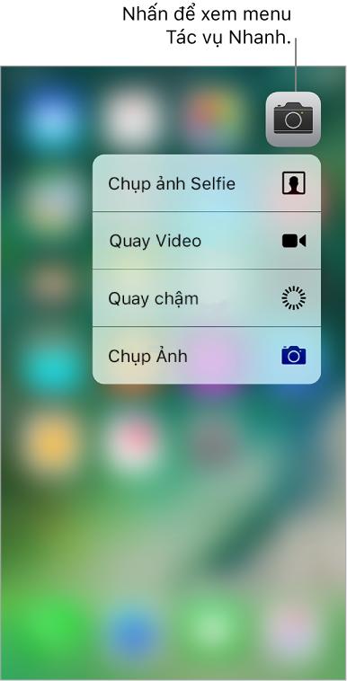 Màn hình chính được làm mờ, với menu Tác vụ nhanh Camera đang hiển thị bên dưới biểu tượng Camera